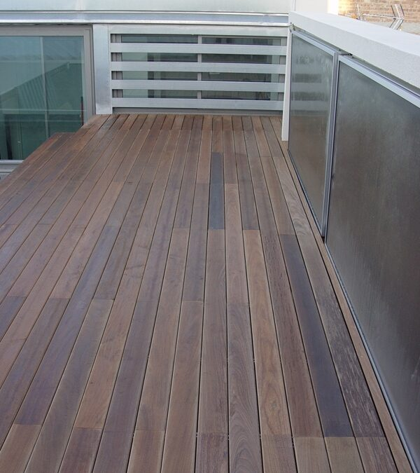 Exterior solid wood platform made of oiled IPE installed over treated pine battens anchored to a preexisting metal structure