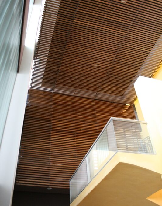 Custom-made ceiling and lattice made with L section of Pine wood,finished in mongoy dyeing and screwed up to steel structure
