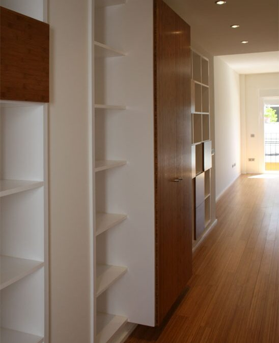 Bespoke wardrobe finish with white lacquering and solid roasted bamboo doors.