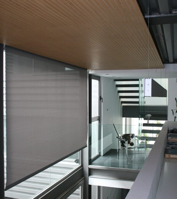 Custom-made wood ceiling with acoustic slotted panels finished in Oak