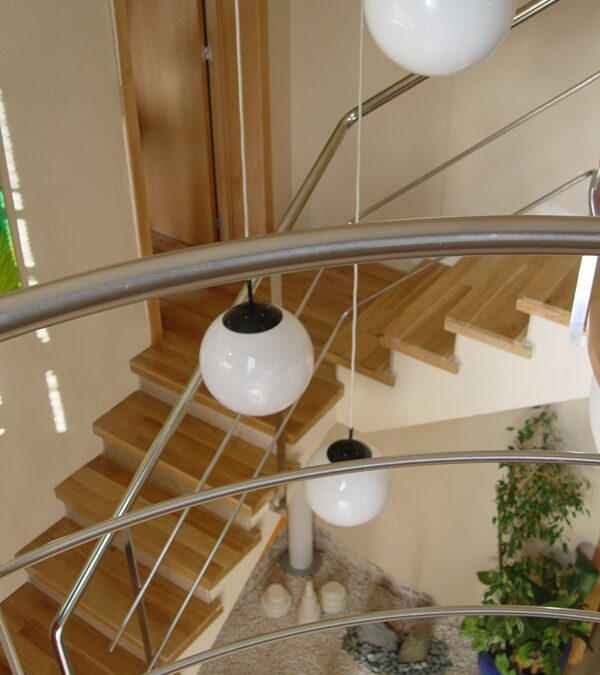A tubular shaped stainless steel handrail