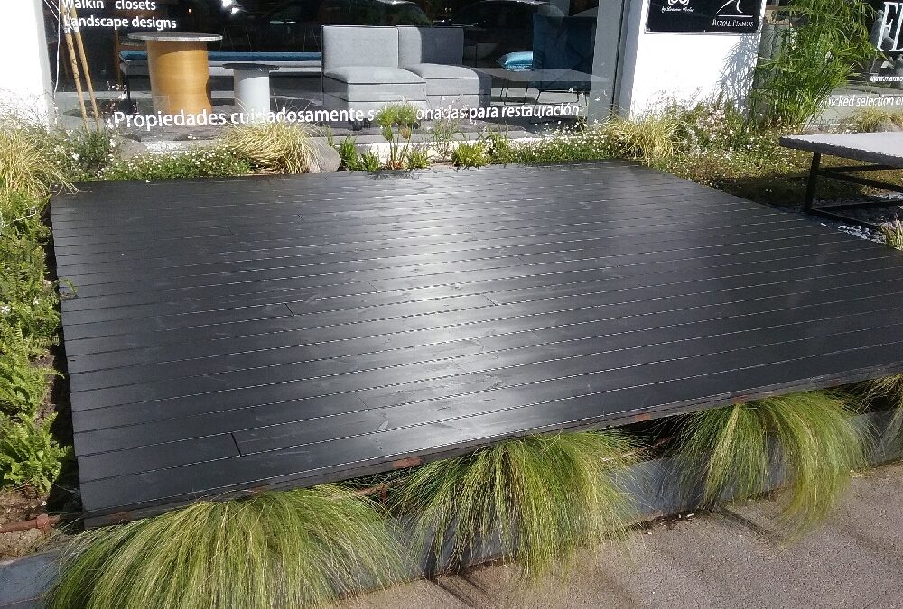 Solid outdoor deck with heat-treated wood finished in black