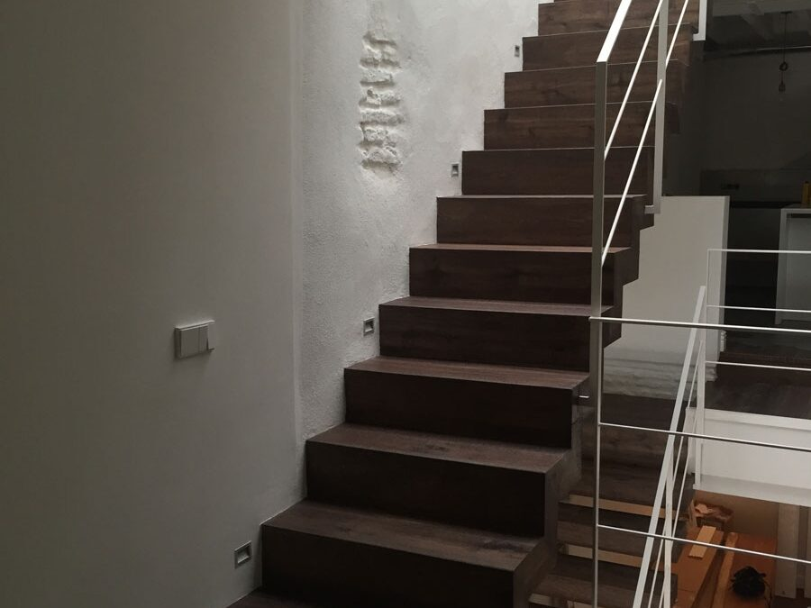 Floating staircase made of tinted oak