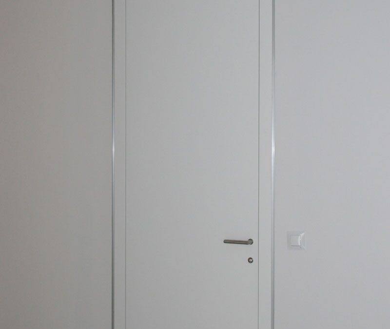 GUBIA minimal door system finished in white laquer